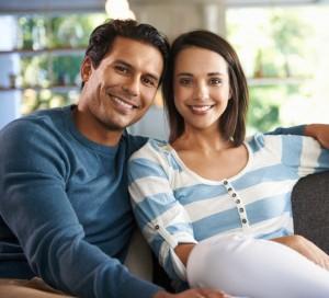 young hispanic couple having pre-marital counseling